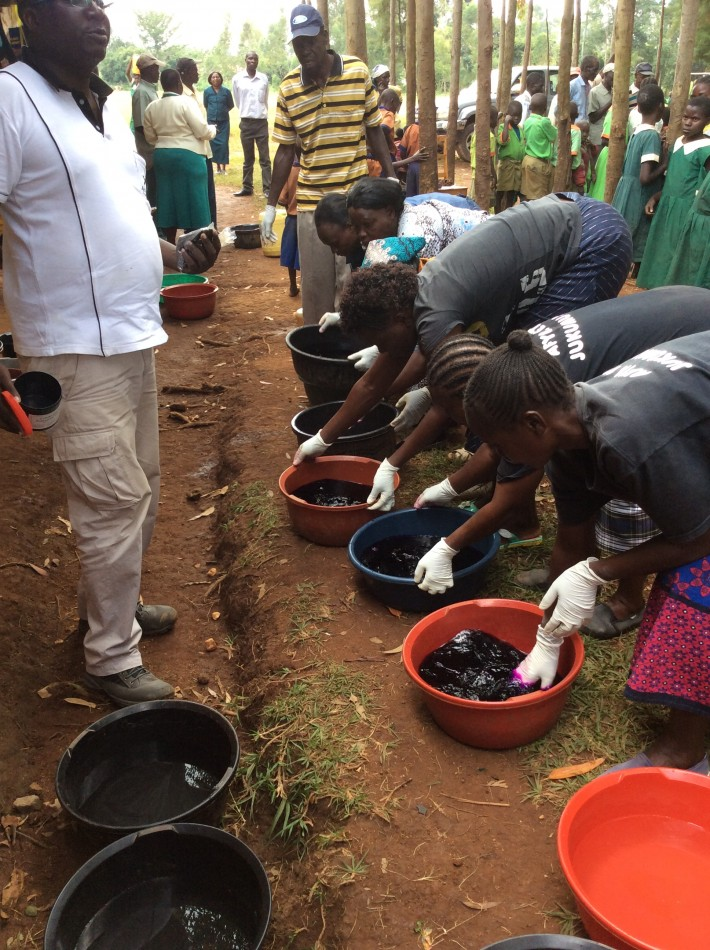 Volunteers preparing the Potassium Permanganate solution for washing infected feet