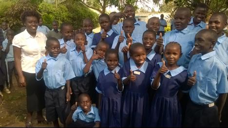 Children receiving new school uniforms