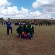 Kisongo Caldicott 1 huddle before kick-off