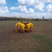 Lemuguru Eton 1 Girls team share some encouraging words before the game begins