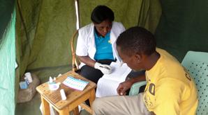 Nurse testing client at Mabogini Village