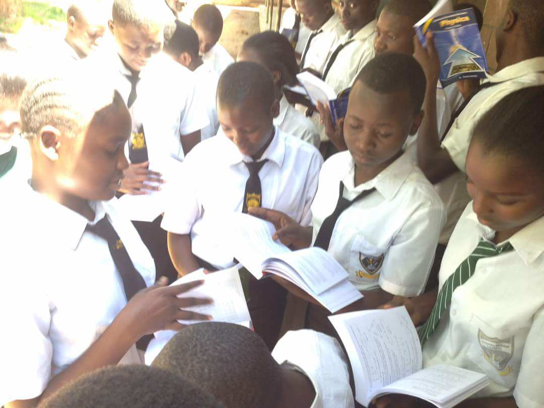 Girls discussing a lesson using donated books in Lusiola mixed secondary in Kakamega