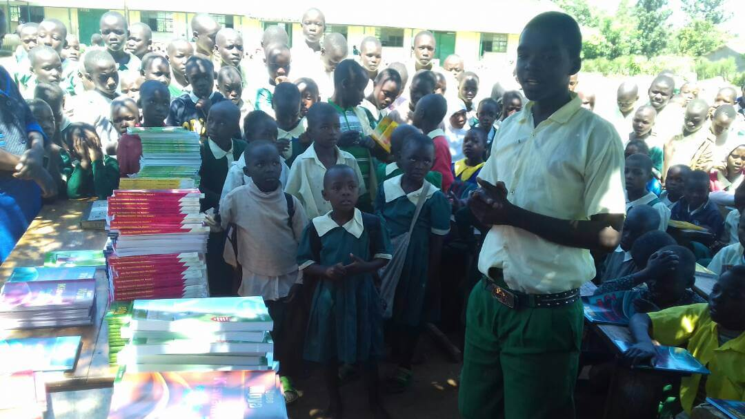 School children giving thanks to Longhorn for book donations at Sango Primary School.