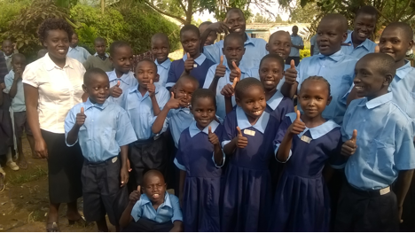 Children receiving new school uniforms