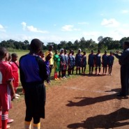 Final words from the guest of honour before the Kindi Kati vs Umoja girls game commences