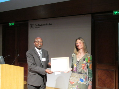 Augustine receiving the award with Egmont Finance Manager, Louise Dixon