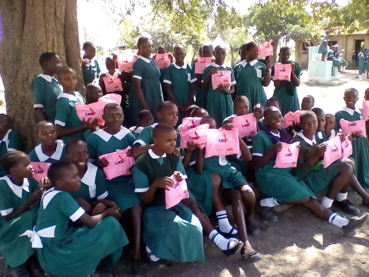 Girls receiving sanitary towel packs